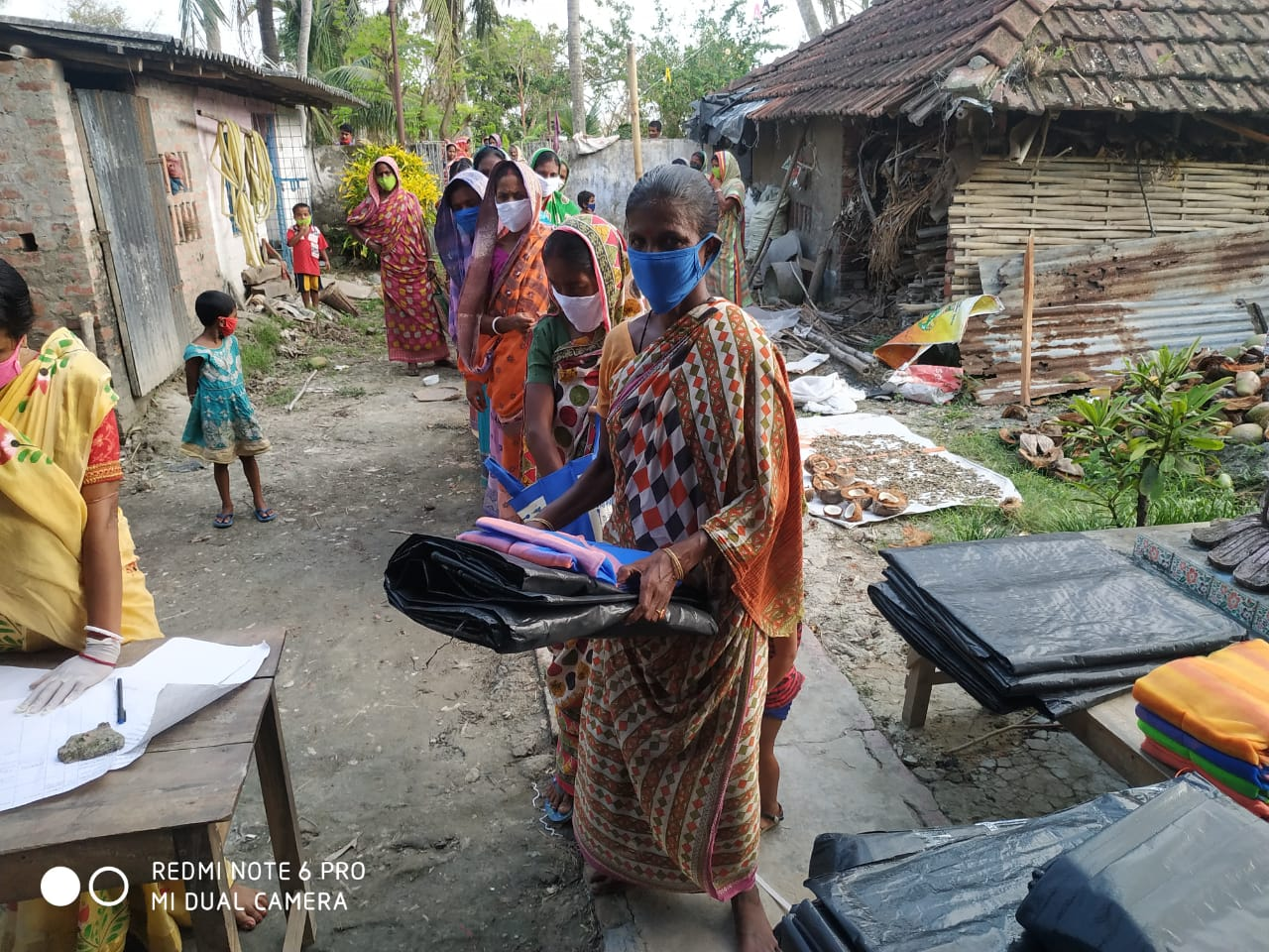 Individual Donors Donate To Mukti For Tarpaulin And Mosquito Net Distribution At Various Places Of Sunderban To Help The Amphan Affected People