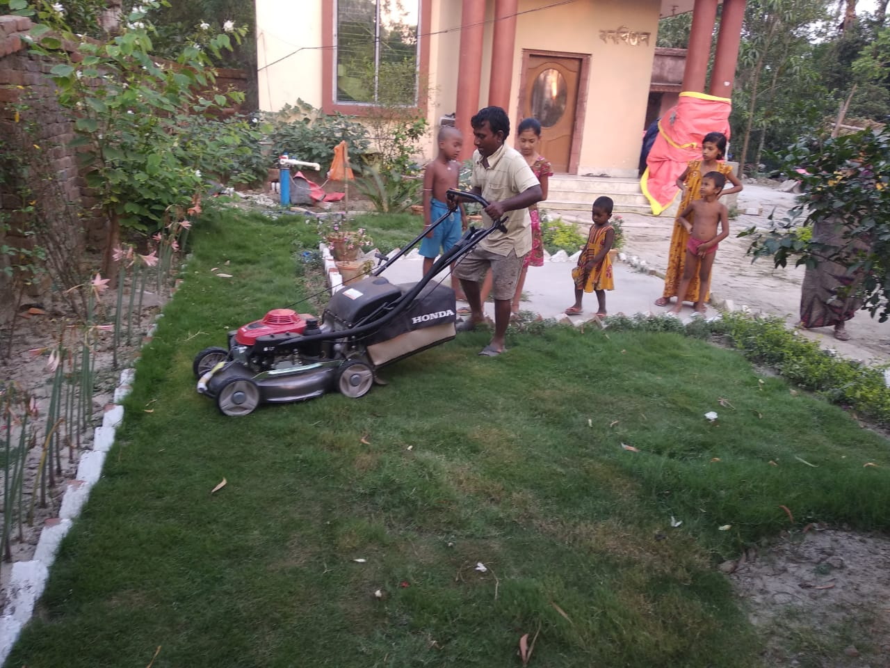 Grass Cutting Work Beside The Roadside Lawn Is Going At Mukt...