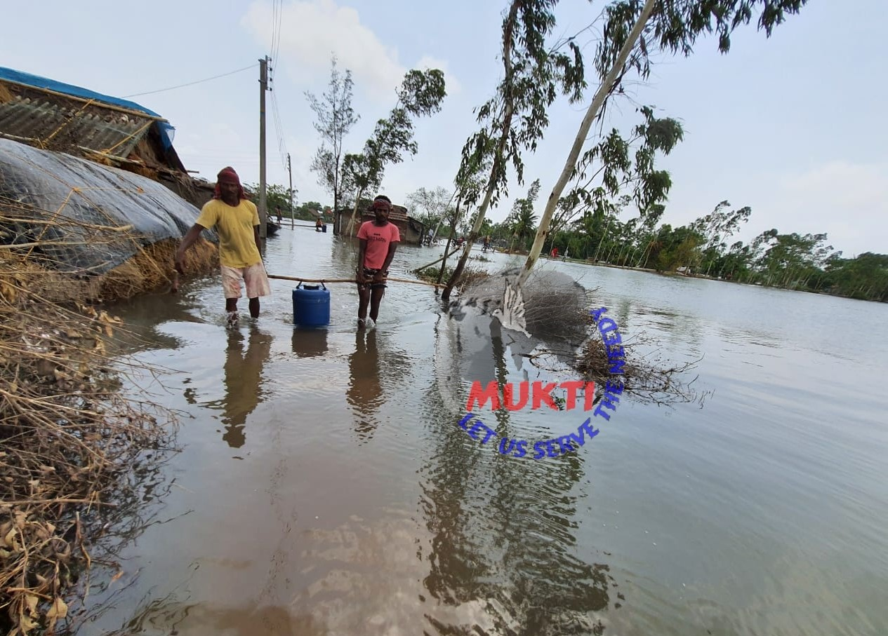 Mukti Providing Potable Water At The Flooded Areas Of Purba ...