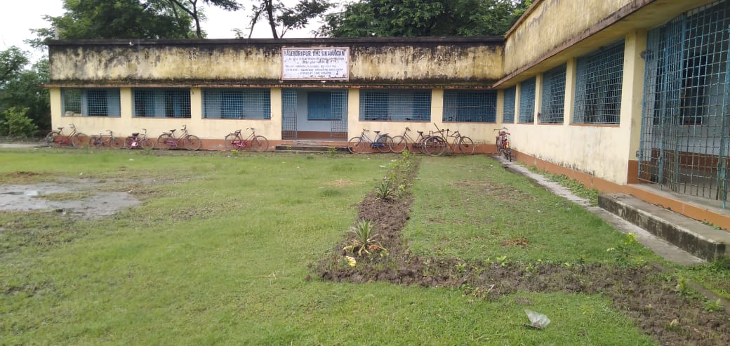 Mukti Is Decorating The Premises Of  Iimc School With Flower And Fruit Saplings At Nagendrapur Gp